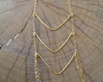 """Necklace... """"Rivers"""" gold necklace with brass hammered wire."""