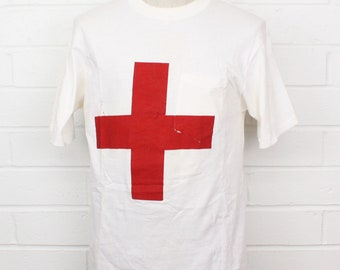 Vintage 1960s Red Cross BVD White Pocket Double Sided Painted Shirt Size XL T-Shirt