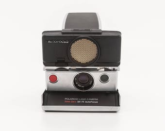 Polaroid SX-70 Land Camera Time-Zero SX70 Autofocus Sonar Converted for 600 film new Black Leather Covering - Film Tested - Working