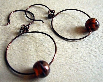 Copper hoop earrings with burnt orange art glass bead