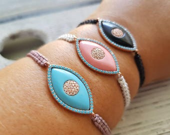 Micro pave Cubic zirconia evil eye bracelet.Light blue,pink,black.Gold plated.Protective.Good luck.Luxury.