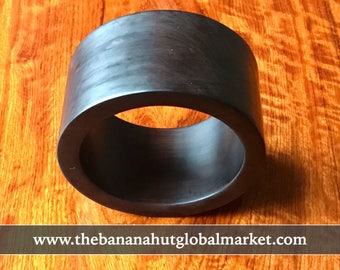 Huge Cuff Bangle fashioned of African Blackwood the ancient Ebony of commerce, Solid, Gaudy, and displaying a sophisticated yet elegant heft
