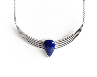 Egyptian Fleet - blue lapiz lazuli and silver arc necklace, streamlined union of five sterling silver wires in a sculptural half moon shape