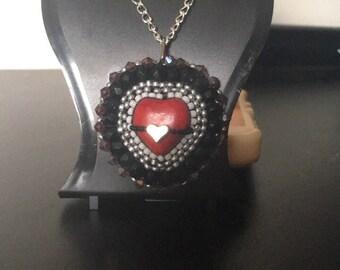 The bleeding heart pendant