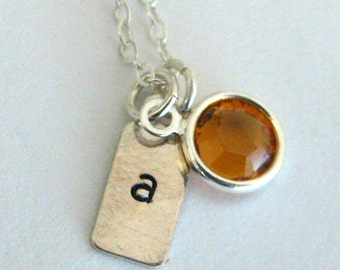 Personalized, hand-stamped, sterling silver and birthstone initial charm necklace.