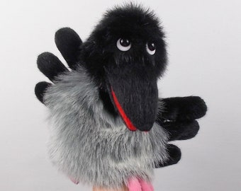 Crow. Toy glove. Bibabo. Toy on hand. Marionette. Puppet theatre.