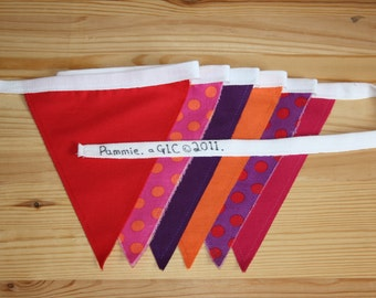 10 metres 'Pammie' style bunting in orange, pink, red and purple.