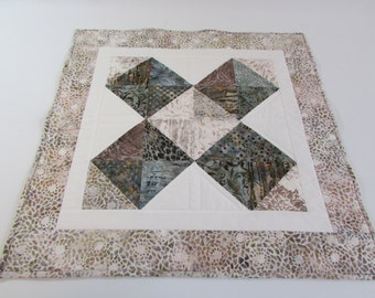Quilted Square Batik Table Topper in blues, browns and cream is a perfect size for your kitchen island or coffee table