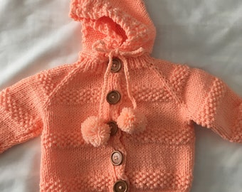 Creamsicle orange hooded sweater, size 6 months.