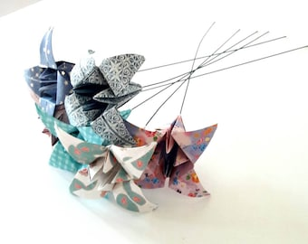 6 Lily made of paper folding origami on steel rod