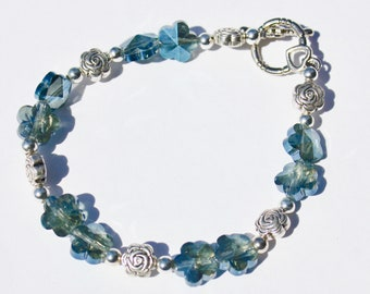 Blue Iridescent Flower Bracelet with Rose Accent Beads