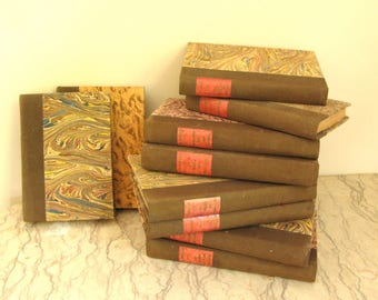 group of vintage 1920's French books in marbled paper bindings