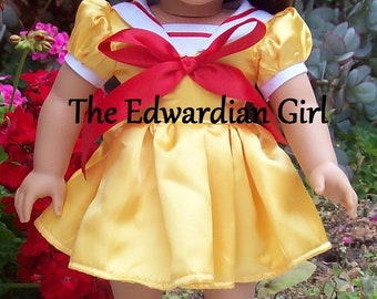 Two of a kind yellow satin sailor's dress. Red satin and cotton. For 18 inch play dolls such as American Girl, Springfield, OG. Made in USA