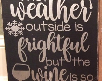 "Hand-painted, wood sign, ""The outside is frightful but the wine is so delightful."""