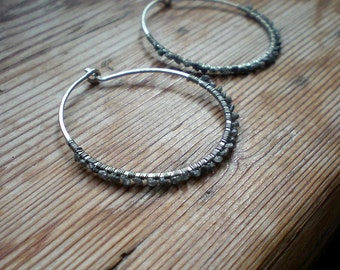 Contemporary silver jewelry, silver hoop earrings, sleek earrings, raw diamond