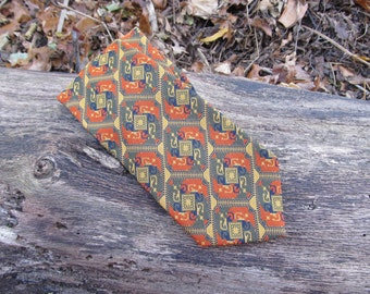 1970s vintage tacky wide tie in rust orange, olive green, and blue