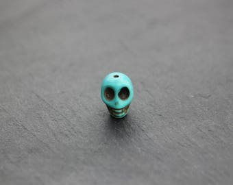 Sold individually turquoise skull bead