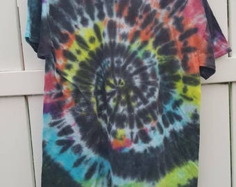 Back and rainbow tie dye shirt.