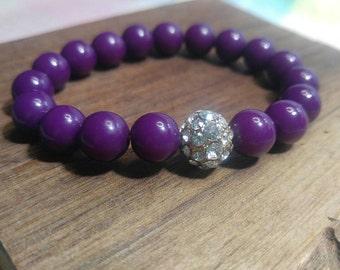 """Purple Plum Lucite 10 mm Bead Bracelet with Rhinestone Accent Bead, 6"""" elastic"""