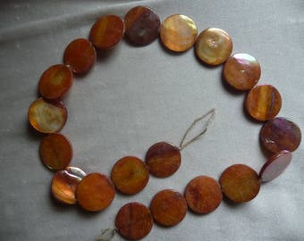 Bead, Mother of Pearl, 20mm Flat Round Coin, Shades of Orange, Very Shiny. Sold per 15 inch strand. There are 20 beads on the strand.