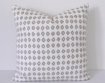 Tan and ivory ikat dots decorative pillow cover