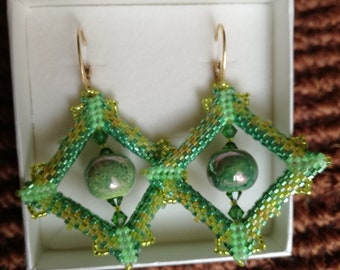 Handmade hand-sewn earrings with glass and ceramic beads