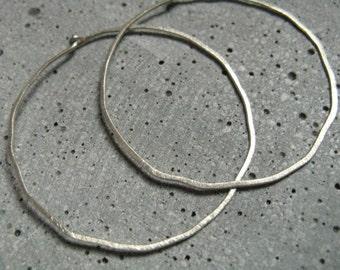 Frost Moon, minimalist hoop earrings, textured silver hoops, hammered silver skinny hoops, contemporary design, modern simple hoop earrings