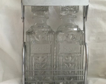 Waterford double decanter set in carry case with retractable handle