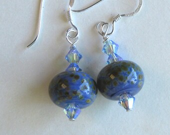 Sterling silver dangle earrings made with purplish-blue SRA lampwork frit beads and light sapphire colored AB2X Swarovski crystals