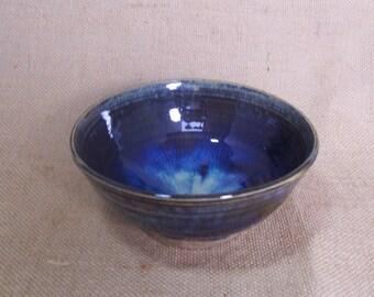Breakfast bowl with blue beige glaze. Ceramics stoneware pottery.