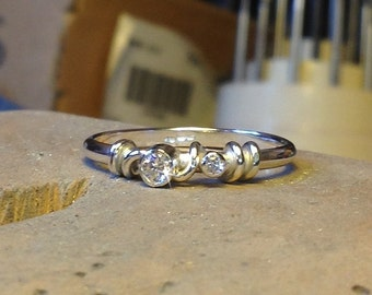 Handmade ring made in recycled sterling silver with 2x lab grown cubic zirconium.