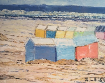 Beach huts in the North of France with movements restless sand and sea.