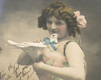 1900s French postcard, Lady with dove. RPPC real photo postcard, paper ephemera.