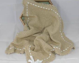 Hand crocheted beige baby blanket