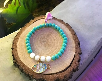 Beaded bracelet with tassel and fish charm