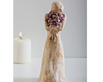 Girl Holding Purple Flowers Sculpture