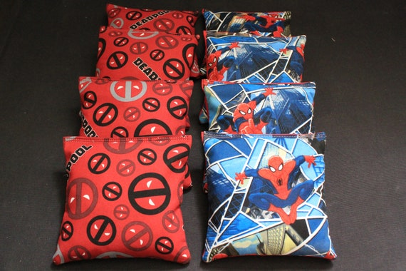 Cornhole bean backs for a fun game of Spiderman vs. Deadpool, anyone??