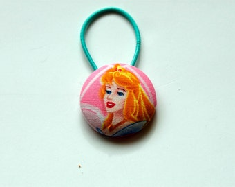 Sleeping Beauty Fabric Covered Giant Button Ponytail Holder
