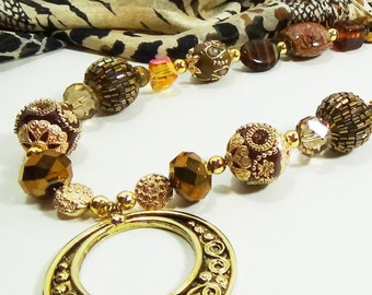Jesse James beads with opulent browns and golds.