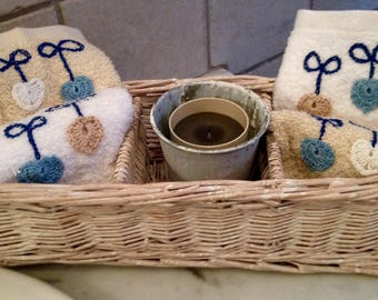Sponge tops with handmade embroidery and application with candle in wicker basket