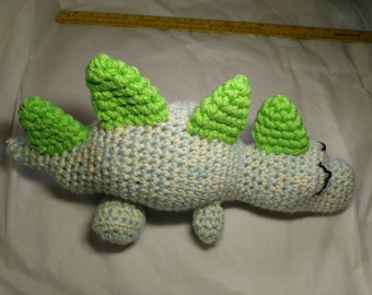 Sleepy Dinosaur, handmade crocheted sleeping stegosaurus stuffed animal, light blue with bright green spikes, ready to ship