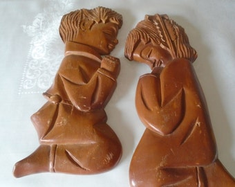 Large pair carved wooden plaques children praying.