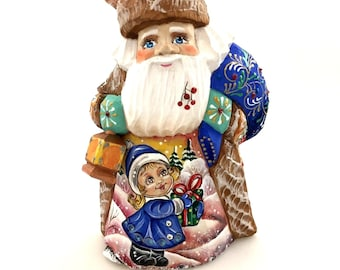 Santa Claus with flashlight, Christmas ornament, handmade and hand-painted figure, ornament for Christmas holidays and home decoration