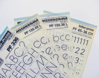 4 rub on lettering sheets, Mecanorma 36 and 48 pt transfer letters