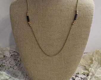 Gold and Black AVON necklace