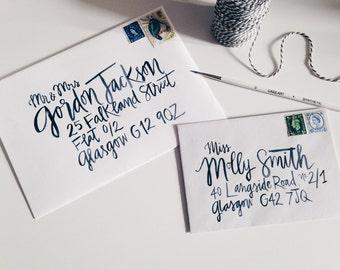 Handwritten brush lettering calligraphy wedding envelopes - Fort Point style