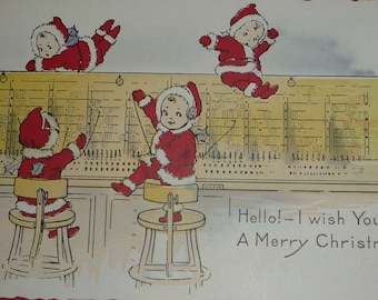 Cute Sprites or Nimble Nicks in Santa Claus Suits Running a Telephone Switchboard Antique Christmas Whitney Made Postcard