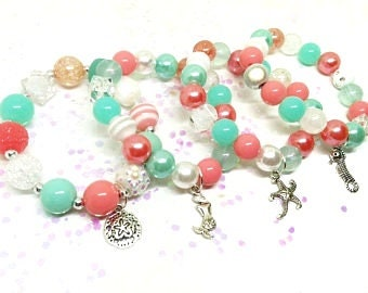 Under the sea Mermaid party favor bracelets in organza bags with special birthday girl bracelet!
