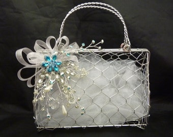 Flower girl metal handbag with a turquoise and silver and white corsage and white voile. Bridesmaids handbag, Flowergirl bag