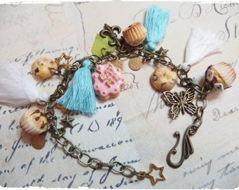 Bracelet charms bronze Alice in Wonderland Eat Me cookie, cupcake, cake, tassel